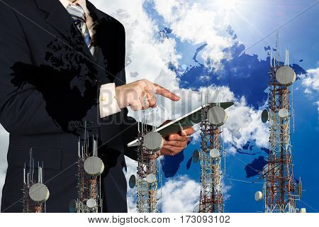 Businessman Working Tablet, Blue Sky And World Map,  Telecommunication Towers Bar Chart.