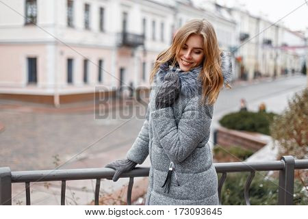 Beautiful Young Woman In Warm Winter Coat Walks In The City.