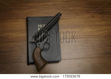 an old revolver on a black bible