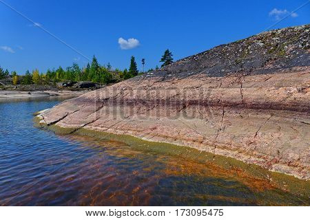 Balaam. The rocky coast of the island. Sunny summer day. Famous Russian Orthodox places