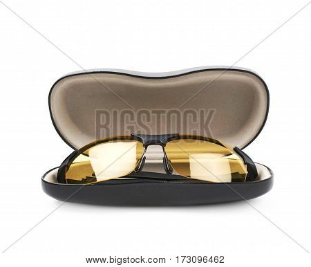 Pair of shade glasses next to a black leather spectacle case, composition isolated over the white background