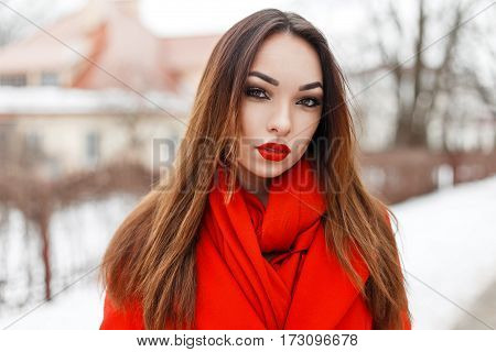 Stylish Beautiful Woman With Red Lips And A Red Scarf On A Winter Day