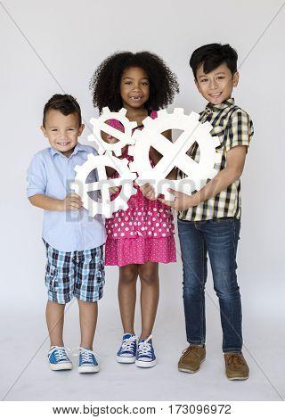 Kids Holding Papercraft Cogwheel Icon