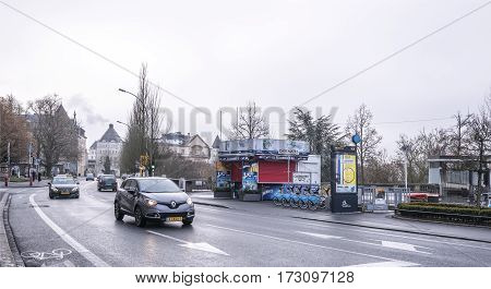 Grand Duchy of Luxembourg Luxembourg- January 032017: Citizens go on on his own business outside moving cars