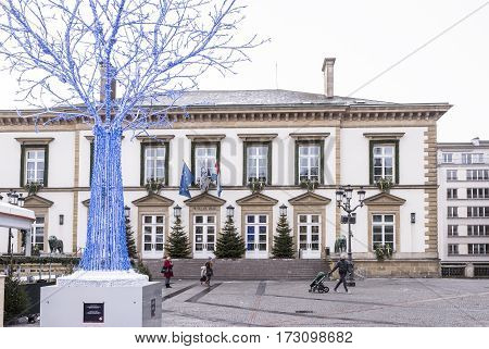 Grand Duchy of Luxembourg Luxembourg- January 032017: Pedestrians with children walk past Hotel de Ville