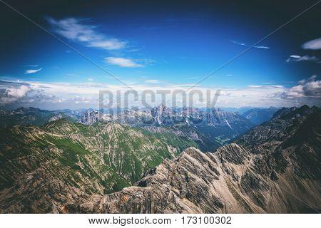 Beautiful birds eye view of the the Krottenkopf mountain peaks in Bavaria with dark vignetted sky