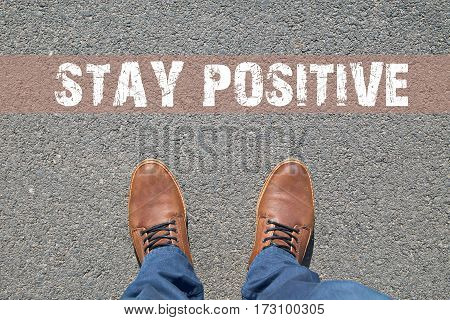 Feet on the street with text Stay Positive