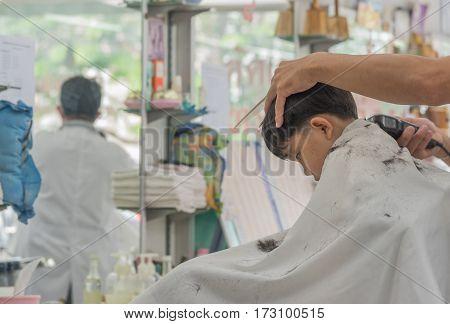 image young asian boy at haircut shop.