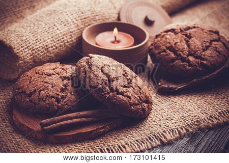 chocolate cookies with chocolate candle on the burlap background