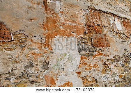 Background of the weathered old stone wall