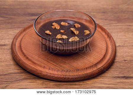 chocolate with nuts, homemade Nutella, food in a glass bowl