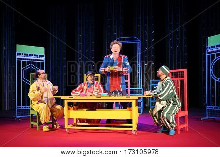 MOSCOW - OCT 19, 2016: Actor are at table during Premium class Performance in Modern theater