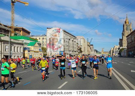 MOSCOW - SEP 25, 2016: Happy participants at Promsvyazbank Moscow marathon amateurs and professionals, athletes again ran 42.2 km on central streets and quays of Moscow