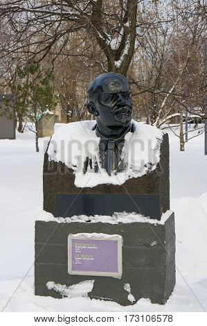 Moscow, Russia - January 17, 2017: Bust of Vladimir Lenin from black granite gabbro. Sculptor Sergei Mercury. Park Muzeon Arts in Moscow