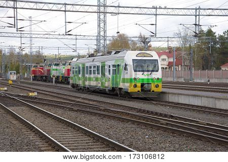 JUVASKULA, FINLAND - MAY 10, 2014: Passenger railcar on the railway tracks of the station Juvaskula