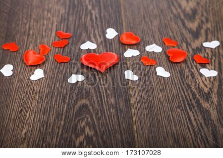 Hearts On A Dark Wooden Background.