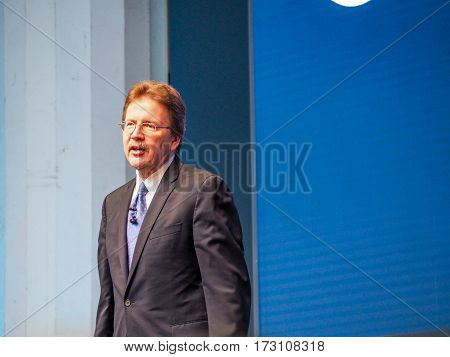 MUNICH GERMANY - FEBRUARY 16 2017: IBM Cognitive Solutions and Research Senior Vice President John Kelly delivers an address to IBM Genius of Things Summit in Munich Germany on February 16 2017.