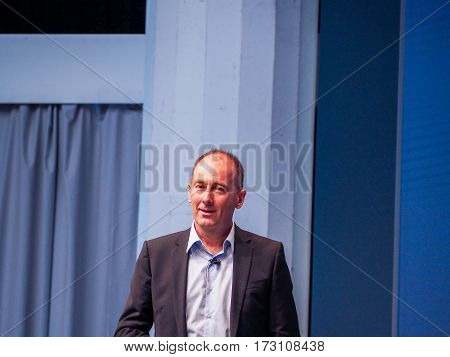 MUNICH GERMANY - FEBRUARY 16 2017: Daimler Director IT Group Siegmar Haasis delivers an address to IBM Genius of Things Summit in Munich Germany on February 16 2017.
