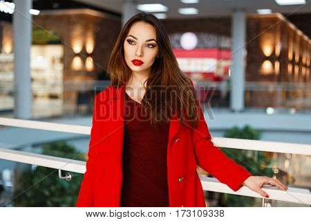 Beautiful Young Girl In A Red Dress Is Shopping