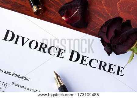 Divorce decree form and faded rose. Separation concept.