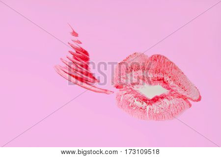 Perfect imprint of pink lipstick. Silhouette of pink lips isolated on white background. Qualitative trace of real lipstick texture. Can be used as a decorative element for print or design.