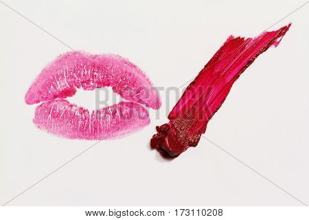 Perfect imprint of pink lipstick. Silhouette of pink lips isolated on white background.