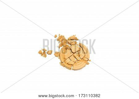 Gold beige eye shadow crushed cosmetic isolated on white background.