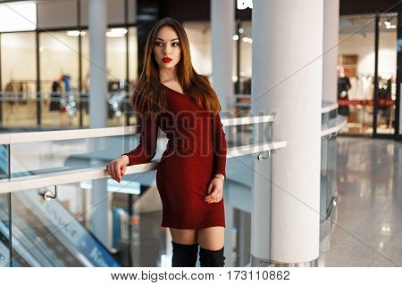 Beautiful Stylish Woman In A Red Dress Shopping  At The Store