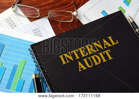Book with title Internal Audit on a table.