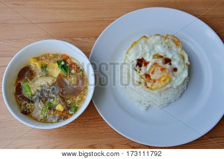 stir fried pork with vegetable in gravy sauce and egg on rice