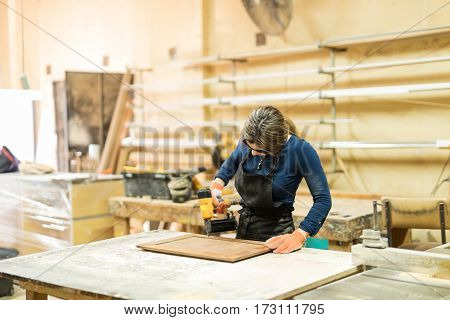 Young Female Carpenter At Work