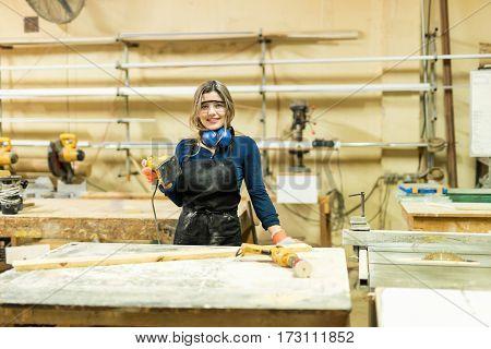 Cute Woman Working As A Carpenter
