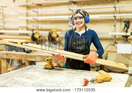 Female Carpenter Enjoying Her Work