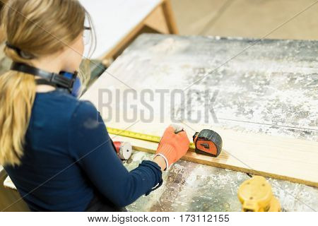 Young Woman Doing Woodwork In A Shop
