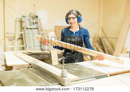Hispanic Female Carpenter At Work