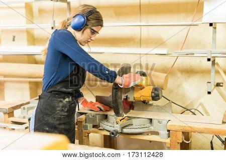 Woman Using A Circular Saw