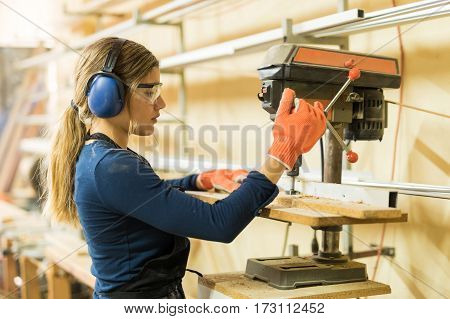 Woman Using A Drill Press For Work
