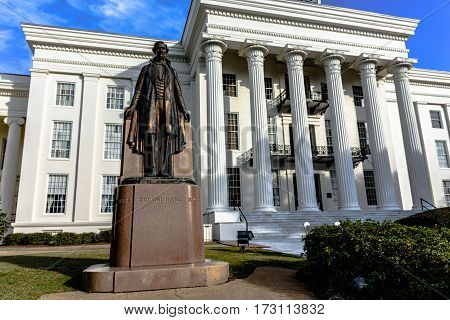 Montgomery Alabama USA - January 28 2017: Statue of Jefferson Davis President of the Confederate States of America prominantly displayed in front of the Alabama State Capitol Building.