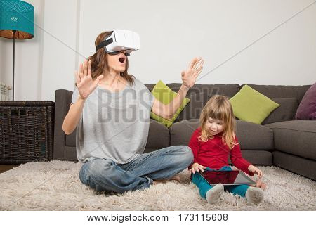 Mother With Vr Glasses And Child With Tablet