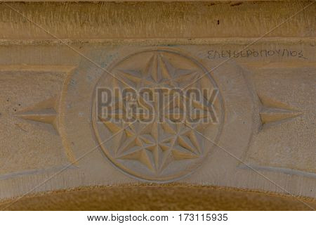 Rethymno Greece - July 31 2016: Bas-relief on the ancient fountaint in Rethymno. Rethymno is the 3rd largest city of the island. Crete attracts 2.8 million annual tourists (2011).