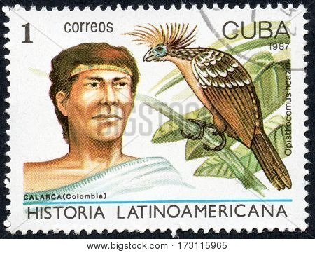 UKRAINE - CIRCA 2017: A stamp printed in Cuba shows Calarca Colombia and bird hoatzin Opisthocomus hoazin the series Latin American history circa 1987