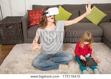 Woman With Vr Headset And Child With Tablet