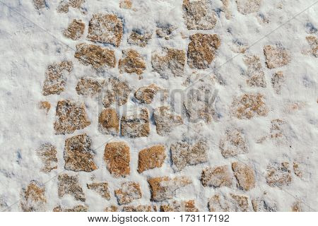 Stone blocks covered with snow. Texture stone