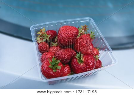 Fresh big strawberries in a plastic box