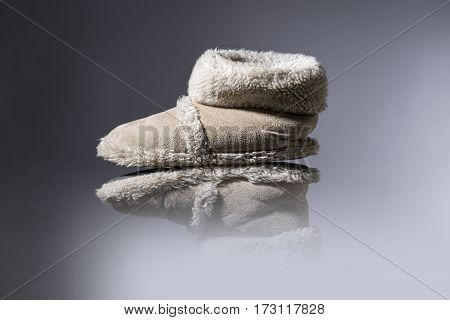 Studio Shot Of Old, Used Slippers With Gray Background