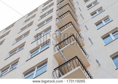 Modern new executive apartment building on white background