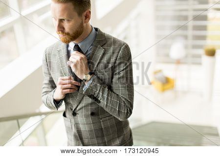 Young Businessman Corrects Tie