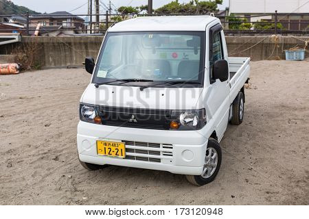 KAMAKURA, JAPAN - NOVEMBER 10, 2016: Fisherman car on the Pacific beach of Kamakura, Japan. Kamakura is a city in Kanagawa Prefecture, about 50 kilometres south-west of Tokyo.