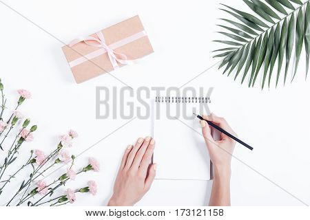 Female Hands Writing In A Notebook, Festive Composition