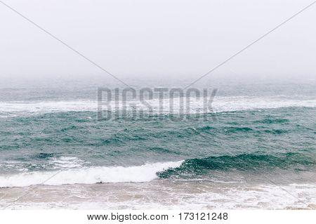 Minimalistic Winter Seascape In Snowy Weather